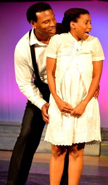 Damien A. Moses as Mister and Giselle Nakhid as Netti in The Color Purple