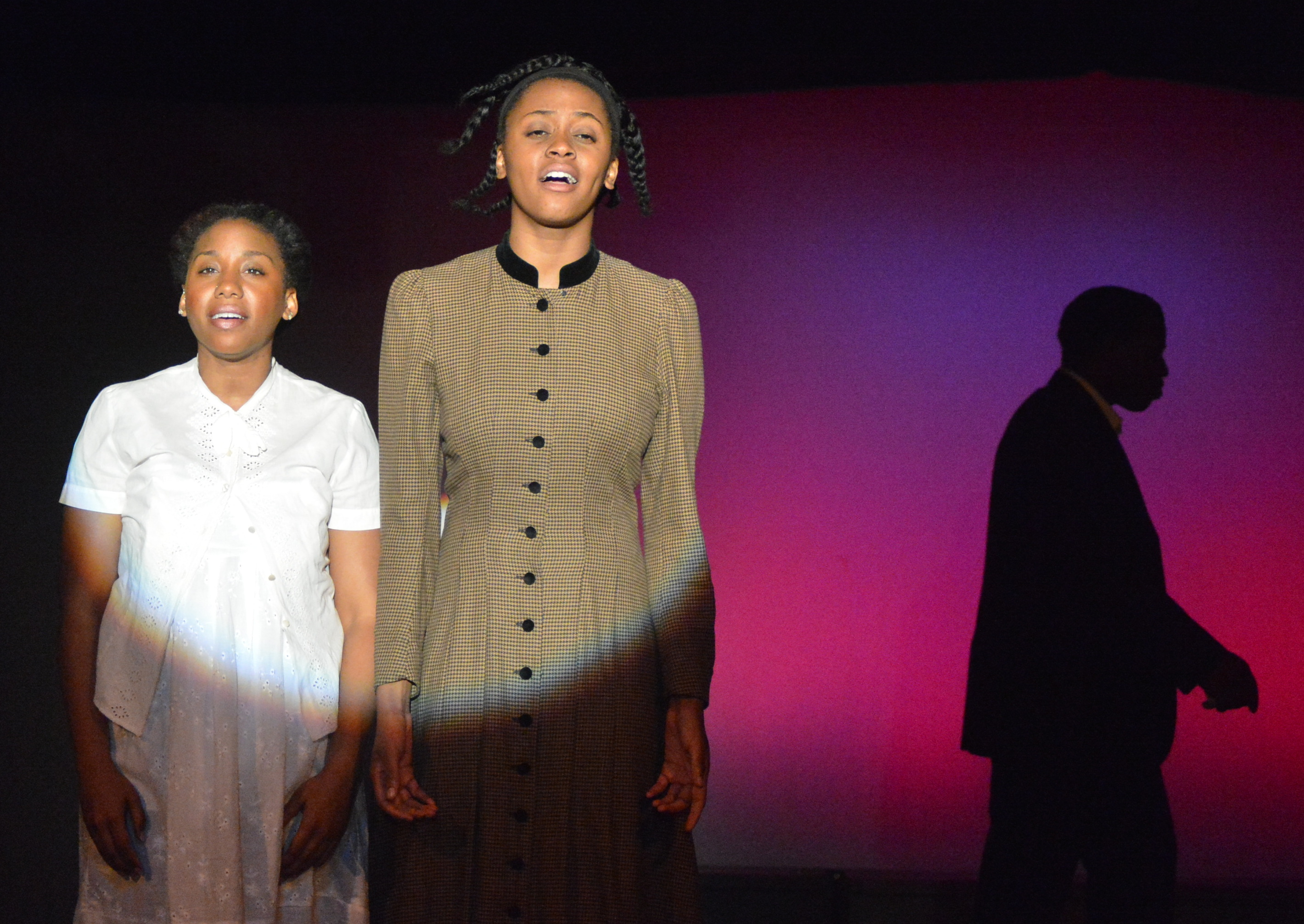 Giselle Nakhid as Netti and Asia Nelson as Celie in The Color Purple